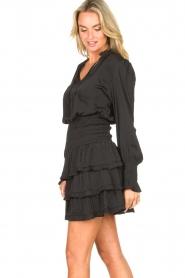 Sofie Schnoor |  Smoked skirt with ruffles Fanya | black  | Picture 5
