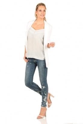 NIKKIE | Gebleekte skinny jeans Brooke lengtemaat 32 | blauw