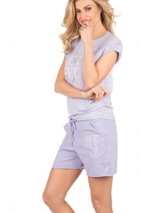 NIKKIE | T-shirt Jetset | lila