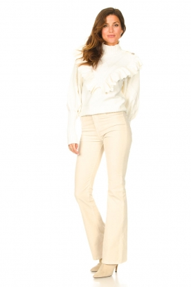 Look Knitted turtleneck sweater with ruffles Ribbar