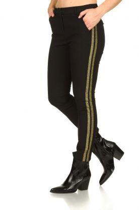Aaiko |  Trousers with gold coloured side stripes Parien | black