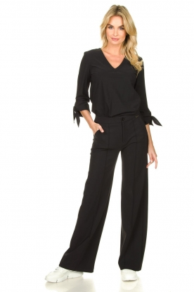 D-ETOILES CASIOPE |  Travel wear flare trousers Trixie | black